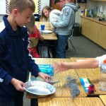 Fifth graders making Martian sand