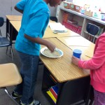 Fifth graders making Martian sand2