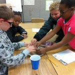 Fifth graders making Martian sand3